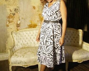 80s zebra print dress, unworn, size 14 to 16.