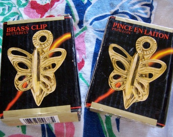 two solid brass butterfly clips