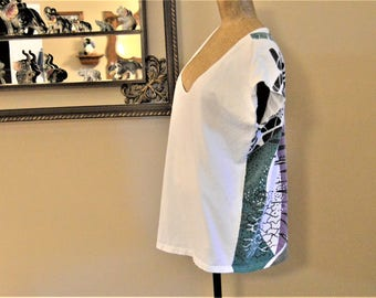 """Emanuelle t shirt, White Front ,80's Designer signed fabric back ,100% Cotton, boxy and oversized,Chest is 34"""" to 46"""" Small to X Large size"""