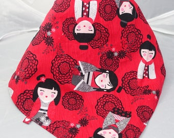 Japanese dolls on a red scarf