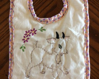 Hand Embroidered baby bib w/ goat on it
