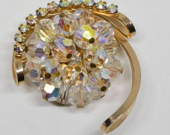 Beautiful gold tone and plastic crystals brooch