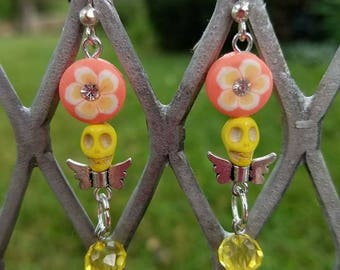 Beautiful handmade earrings with cute little skulls