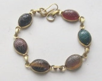 """Bracelet 7.5""""L-6 Egyptian Scarabs made of various gemstones , gold tone metal setting and strong clasp. Each scarab has hieroglyphs on back."""
