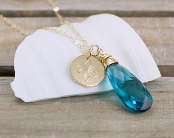 London Blue Topaz Gold Gemstone Necklace - Teal Blue Topaz Pendant - Fleur De Lis Charm - Gemstone Charm Necklace - Mothers Day Gift For Her