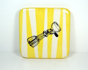 tile with a handmixer print on yellow vertical stripes. ready to ship