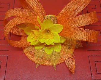 Orange and yellow fascinator