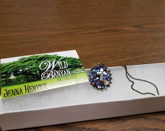 Jeweled pendant necklace featuring cross and heart
