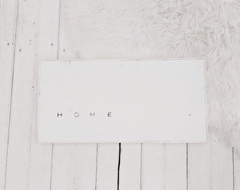 home black and white wood sign