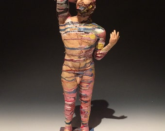 Ceramic figure sculpture, naked man going through it, standing nude figurine with painting drips, mature art