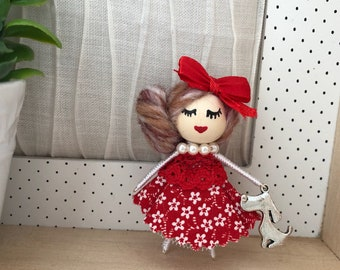 Doll brooch with dog