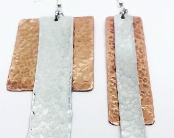 Mis-matched pair of earrings. Copper earrings. Bold earrings. Asymmetric earrings