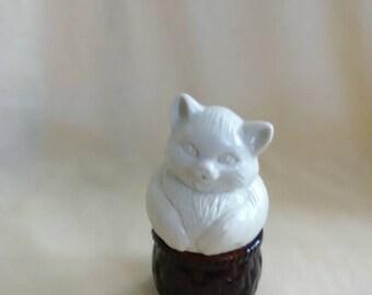 Vintage Avon perfume bottle. Cat on a basket