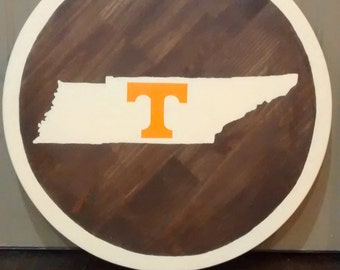 Tennessee Vols painted on 23.75 in pine wood round.