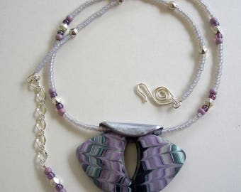 Purple, Black, and Green Shield Shaped Pendant with Self Bail and Beaded Necklace to Match by Carol Wilson of PollyClayDesigns