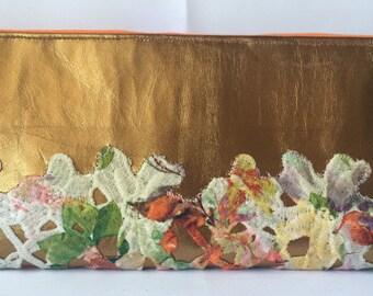 RivAgo clutch in bronze leather