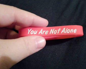 You Are Not Alone Wristband's - Crossroads Red