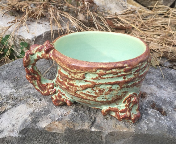 medium sized handled soup bowl in pale green and reddish brown