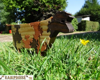 Daisy puzzle: Norman wooden cow
