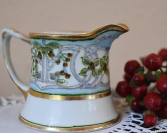 Antique Nippon creamer, maple leaf mark,  Red Berries green leaves blue and gold accent decoration. circa 1891-1911.