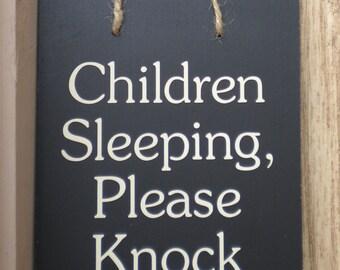 Children Sleeping, Please Knock wood sign