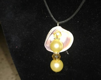 Yellow pearl with seashell