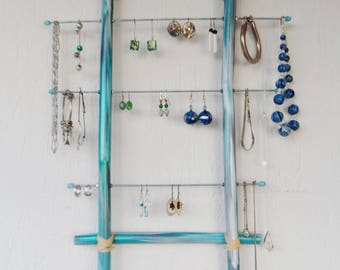 Blue bamboo wall jewelry holder