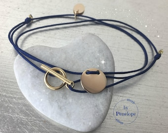 Gold plated Medal and on dark blue DrawString toggle bracelet