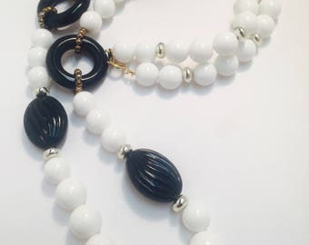 Vintage black and white lucite necklace .