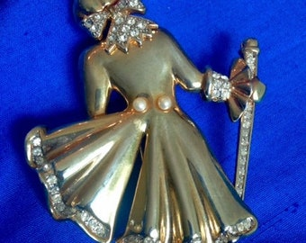 Vintage brooch of girl with staff
