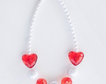 The perfect and simple red and pearl white heart necklace.  Perfect for Valentine's day and is just over 17 inches long. Ready to ship!