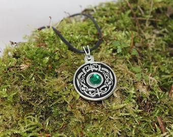 Dragon eye, silver and green stone pendant