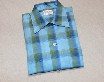 vintage 1960's -Penney's- Men's long sleeve loop collar shirt. 'New Old Stock'. Shadow fade plaid in vibrant Blues & Green. Small