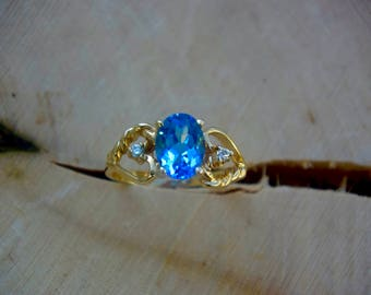 14kt. Gold Blue Topaz and diamond Ring