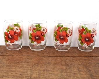 Set of four, retro vintage tumbler glasses from the 1960's festive red flower design.