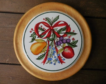 Vintage 1980s to 1990s Ceramic Tile and Wood Dansk Trivet Thailand Round Christmas Themed Fruit Holly and Berries Red Bow