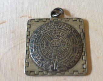 Mayan calendar pendant.