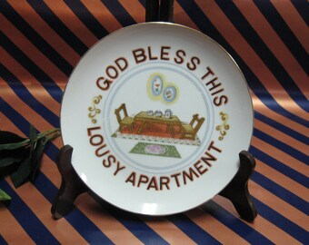 Vintage God Bless This Lousy Apartment Hanging Plate Novelty Item but makes a great gift.