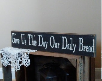 Give us this day our daily bread sign. This sign was made of old barnwood. Great for a gift!