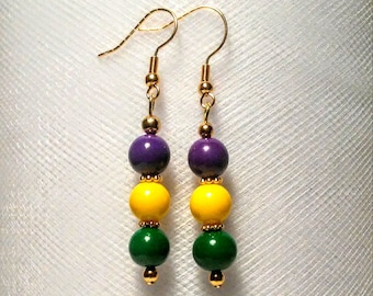 Long Mardi gras earrings made with purple, gold and green glass beads with gold metal accents