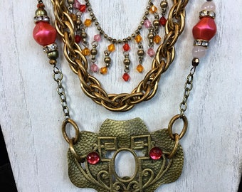 Romantic vintage assemblage necklace with three strands antique brass pinks rhinestone and beads