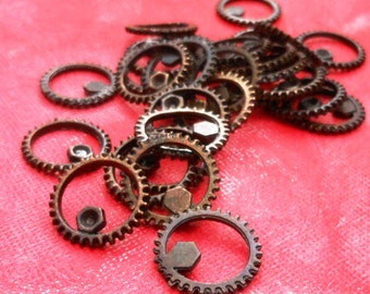 antiqued cogs and gears , small SPUR steampunk GEAR - antiqued patina 4 pcs