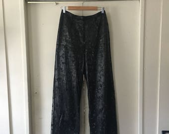 Sparkly flare pants with all over floral print