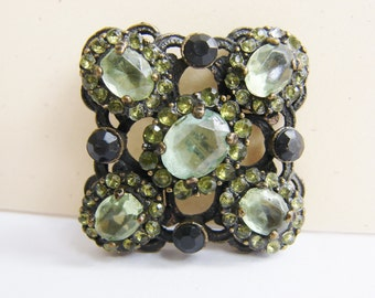 Vintage art deco style antiqued brass flower brooch with  green and black rhinestone accents (I1)