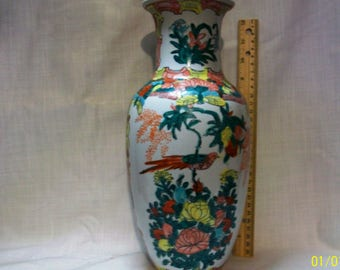 Listing 102 is an Ornate Chinese porcelain vase