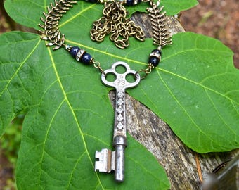 Skeleton Key Necklace with Blue Goldstone Beads and Vintage Rhinestones with fishbone chain handmade antique assemblage jewelry gift