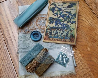 The Curated Collections: The Blue Bird Collection mixed media and fabric collage kit