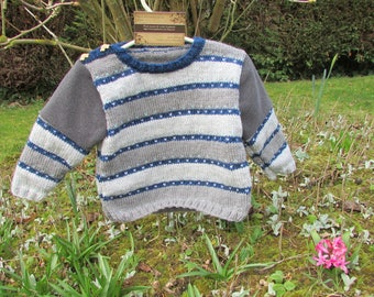 Gray and blue striped knitted sweater
