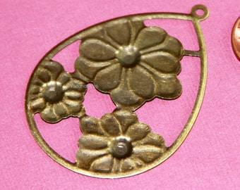 10 pcs of Antiqued brass teardrop with flower 39x54mm