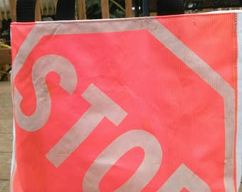 STOP totes - limited edition - made from repurposed STOP flags and waterproof tent awning